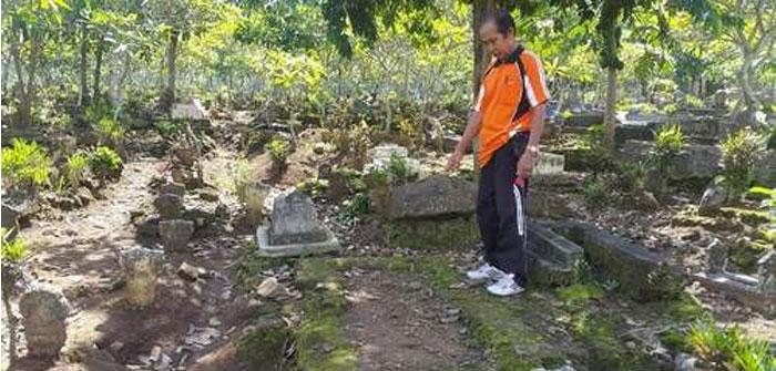 Warga Desa Tulungrejo, Kecamatan Glenmore, Banyuwangi, sudah menyiapkan liang lahat untuk Angeline. Bocah berusia 8 tahun itu akan dimakamkan di sebelah kakeknya. [Foto: Repro-Detik.com]